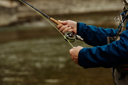 Man fishing in river, close-up