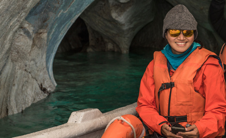 Woman admiring the marble caves, Catedral de Marmol, Chile