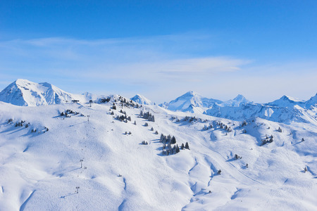 Snow covered mountain landscape, Gstaad, Switzerland LANG_EVOIMAGES