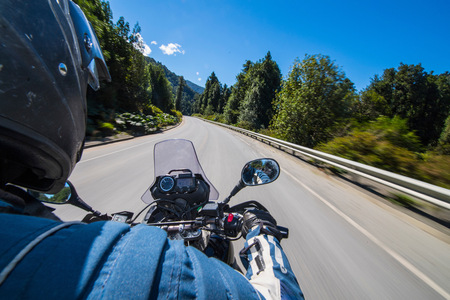 ruta: Man driving on a touring motorbike on Ruta 7 - the Carretera Austral in Patagonia