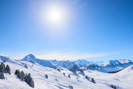 Sunlit snow covered mountain landscape, Gstaad, Switzerland LANG_EVOIMAGES