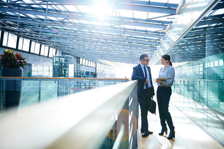 balcony: Businessman and woman meeting on office balcony