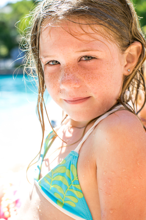 top 7: Close up portrait of girl by swimming pool