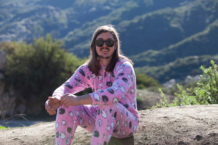 getting out: Portrait of man wearing pink onesie, Malibu Canyon, California, USA