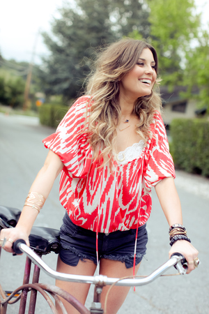 Young woman with tandem bicycle on rural road LANG_EVOIMAGES