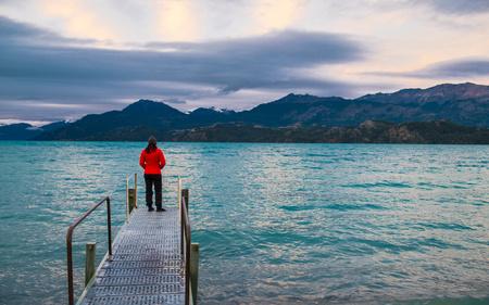 Woman standing on pier at Lago Rio Tranquillo,Carretera Austral,Aysen,Chile