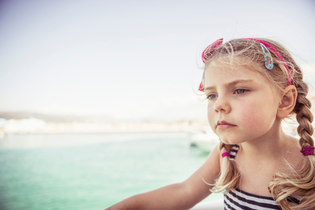 3 4 years: Portrait of young girl near water,pensive expression