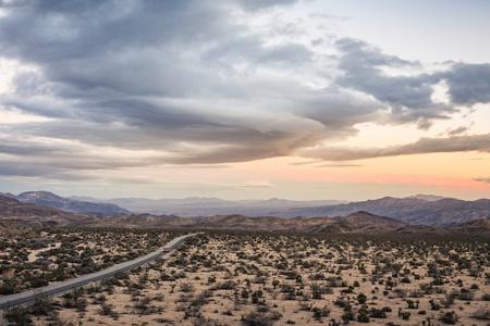 joshua tree national park: Landscape view of distant highway in Joshua Tree National Park at dusk,California,USA