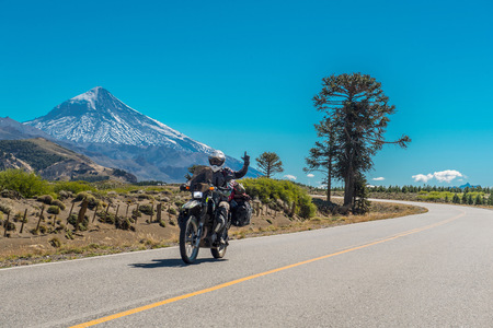 Woman on touring motorbike in South America