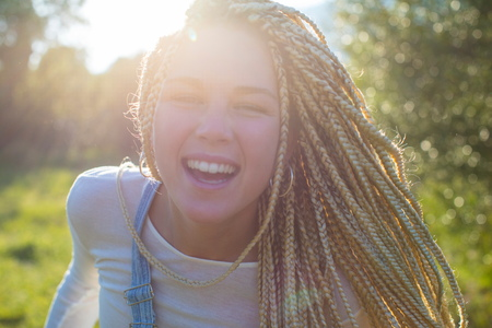 palma: Portrait of happy young woman with long plaited blond hair in field,Majorca,Spain