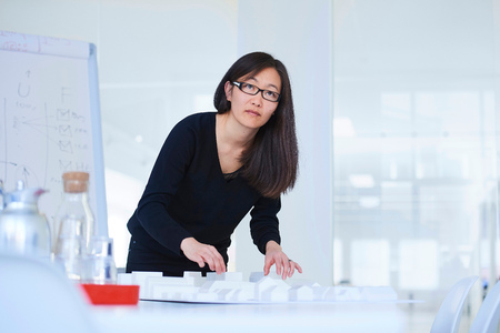 Portrait of businesswoman in architect office looking at camera LANG_EVOIMAGES