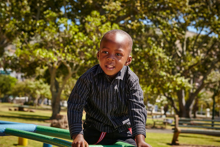 3 4 years: Boy on climbing frame in playground