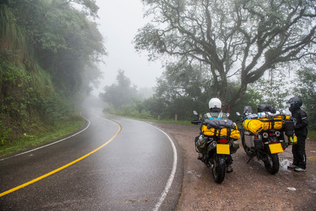 roadside stand: Two women with touring motorbikes in rain forest,Jujuy,Argentina,South America