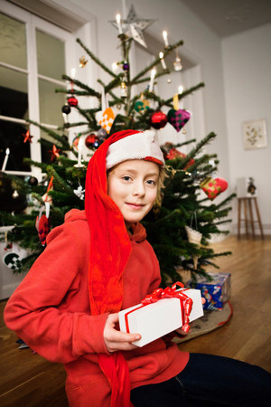 Smiling boy holding Christmas gift