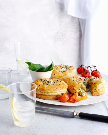 Plate of puff pastries with tomatoes