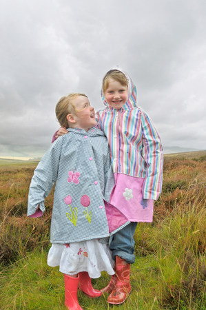 scottish female: 2 little girls laughing in the moorlands