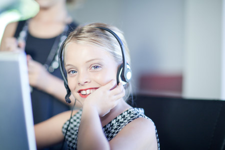technology: Girl playing businesswoman at desk
