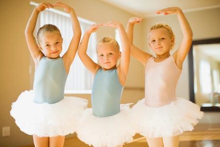 Girls in ballet costumes posing