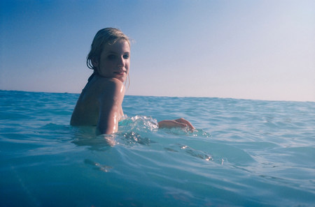 Woman in blue sea LANG_EVOIMAGES