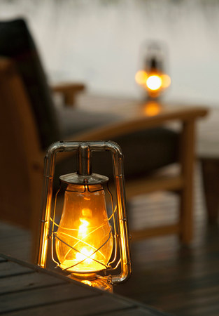 oil lamp: Lanterns glow at Abu Camp,a luxury safari camp in the Okavango Delta,Botswana