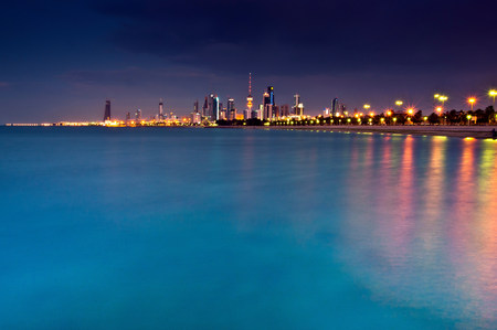 reflective: Streetlights reflected in urban harbor