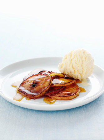 sultry: Plate of cooked fruit with ice cream LANG_EVOIMAGES