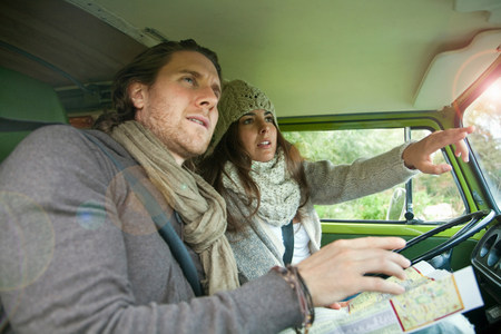 figuring: Couple figuring out directions in van