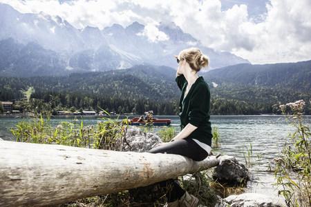 Woman overlooking rural lake LANG_EVOIMAGES
