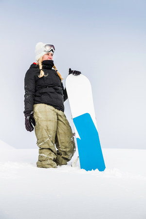 wildkogel austria: Portrait of young female with snowboard,Reutte,Tyrol,Austria LANG_EVOIMAGES