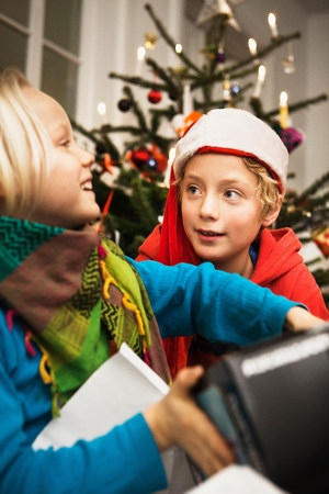 Children opening Christmas gifts LANG_EVOIMAGES
