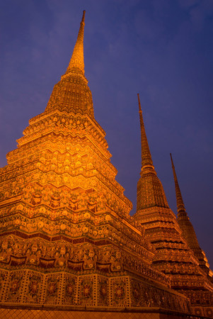 in low spirits: Ornate carved spires lit up at night