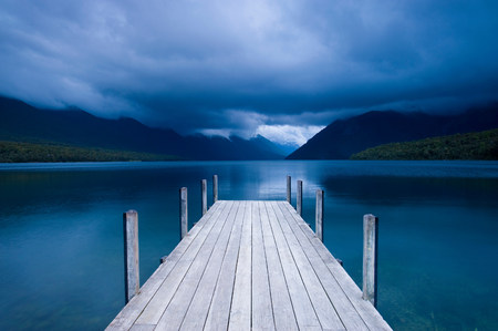 getting out: Wooden pier stretching into still lake LANG_EVOIMAGES