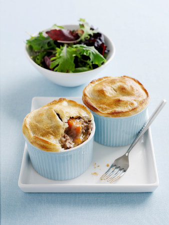 sultry: Dishes of mini pot pies with salad