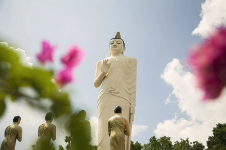 in low spirits: Buddha at Temple at base of Sigiriya (Lion Rock) Rock Fortress,Sri Lanka LANG_EVOIMAGES