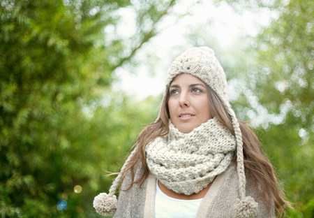 Woman wearing hat and scarf outdoors LANG_EVOIMAGES