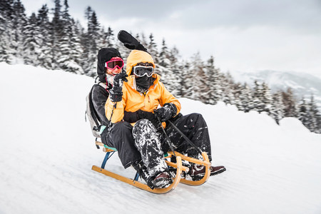 wildkogel austria: Young couple sledging,Bramberg am Wildkogel,Austria