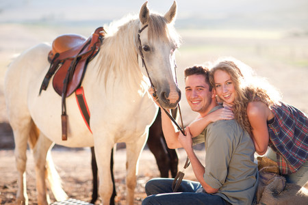 Young couple with horse LANG_EVOIMAGES