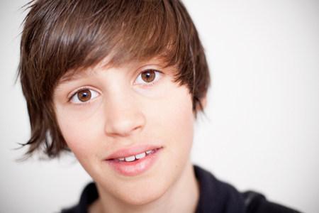 Close up of smiling teenage boy