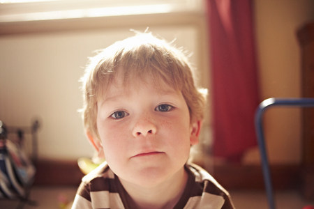 english ethnicity: Close up of boys curious face LANG_EVOIMAGES
