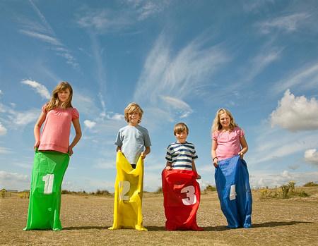 Children having sack race on beach