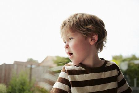 Boy sitting at window LANG_EVOIMAGES