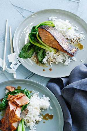 Plates of fish,rice and greens LANG_EVOIMAGES