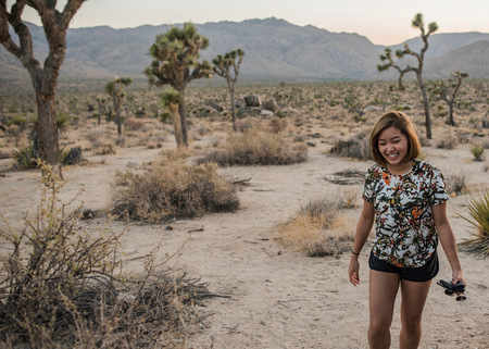 joshua tree national park: Young woman in Joshua Tree National Park at dusk, California, USA LANG_EVOIMAGES