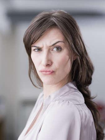 Woman making face at viewer