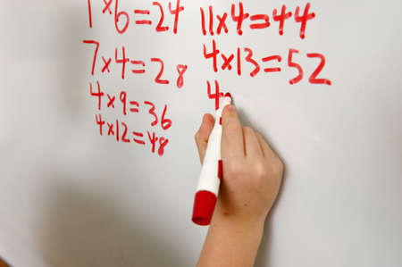 multiplication: Student working on math problem LANG_EVOIMAGES