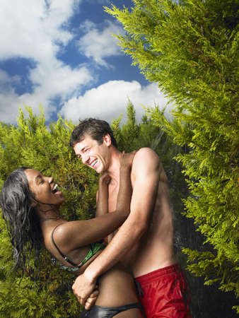 saturating: Couple in swimsuits, laughing
