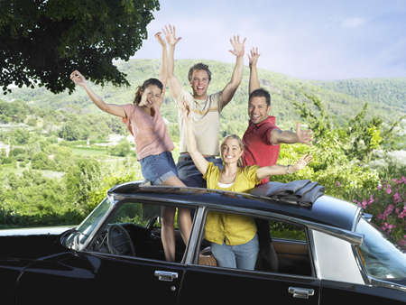 rooting: Four friends waving out of car