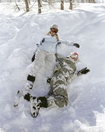 mischeif: Couple sitting in snow,  laughing