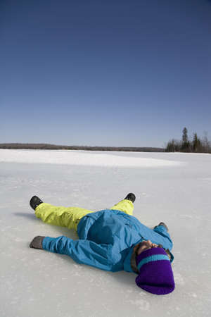 Woman Lying on Frozen Lake LANG_EVOIMAGES
