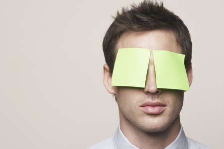 confines: Business man with post-it notes on eyes